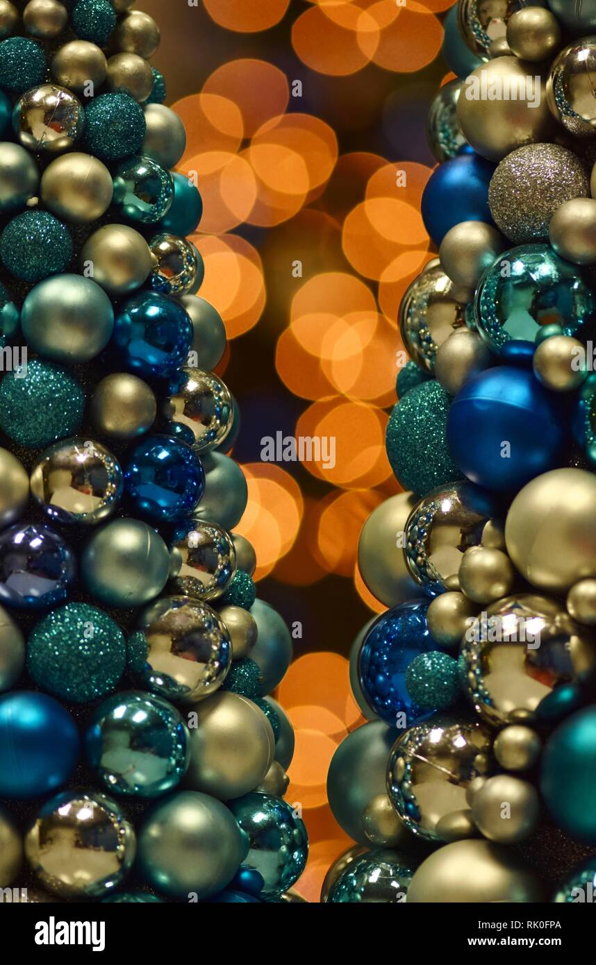 Orange Colored Bokeh Lights With Blue Christmas Tree Baubles In The Foreground Giving It An Abstract Look Stock Photo Alamy