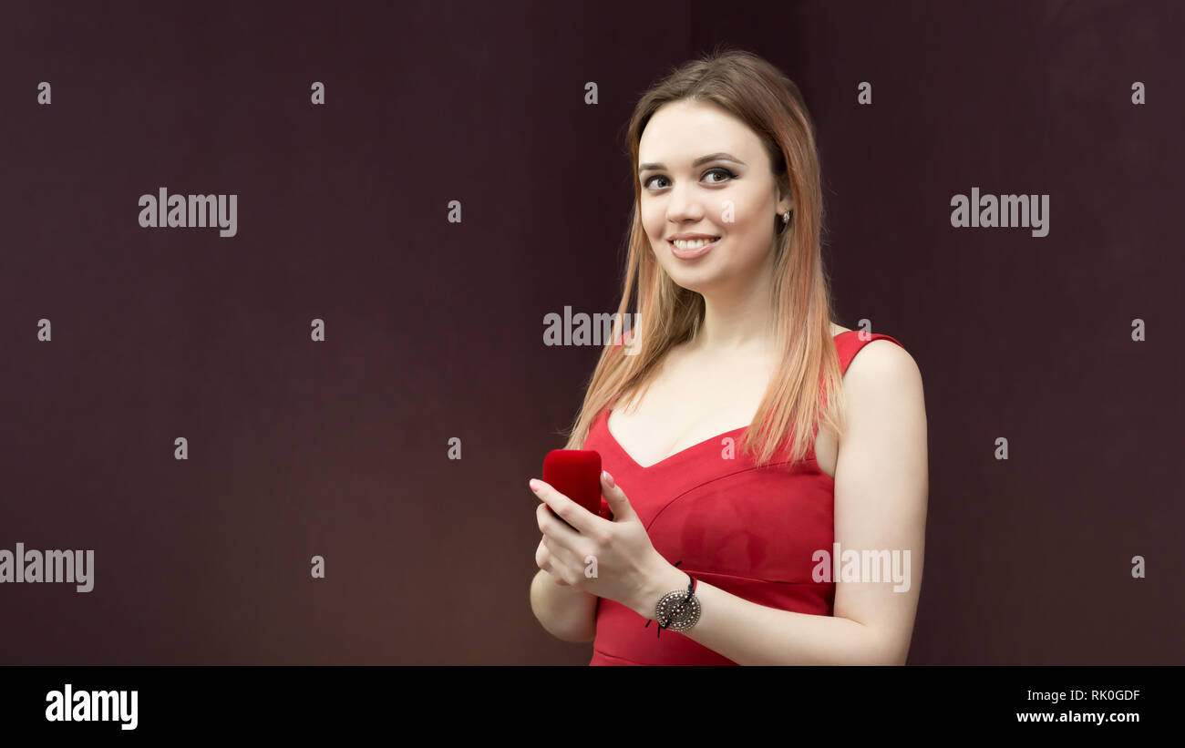 f4303d3e55eb6 Portrait of a woman in a red dress which gave a wedding ring. - Stock