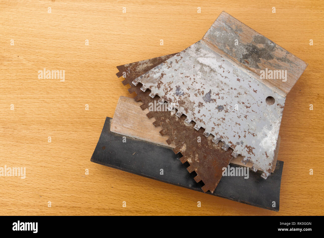 Glue spreader for cement and building blocks in use for constructions - Stock Image