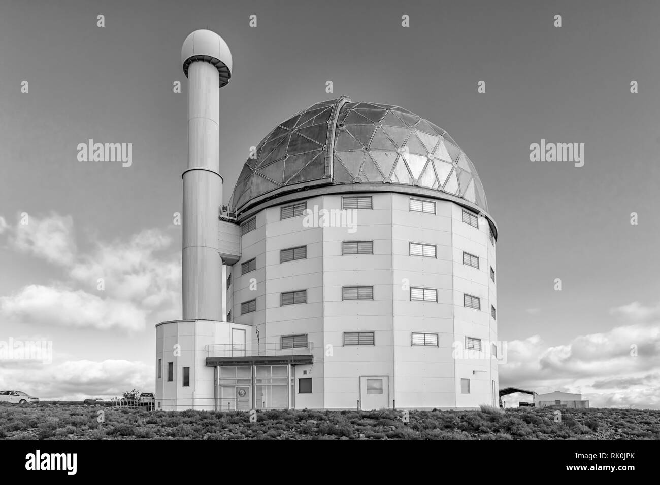 SUTHERLAND, SOUTH AFRICA, AUGUST 7, 2018: Building of the SALT 11-meter telescope at the South African Astronomical Observatory near Sutherland. Vehic - Stock Image