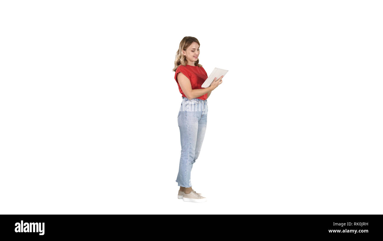 Woman in casual using tablet on white background. - Stock Image