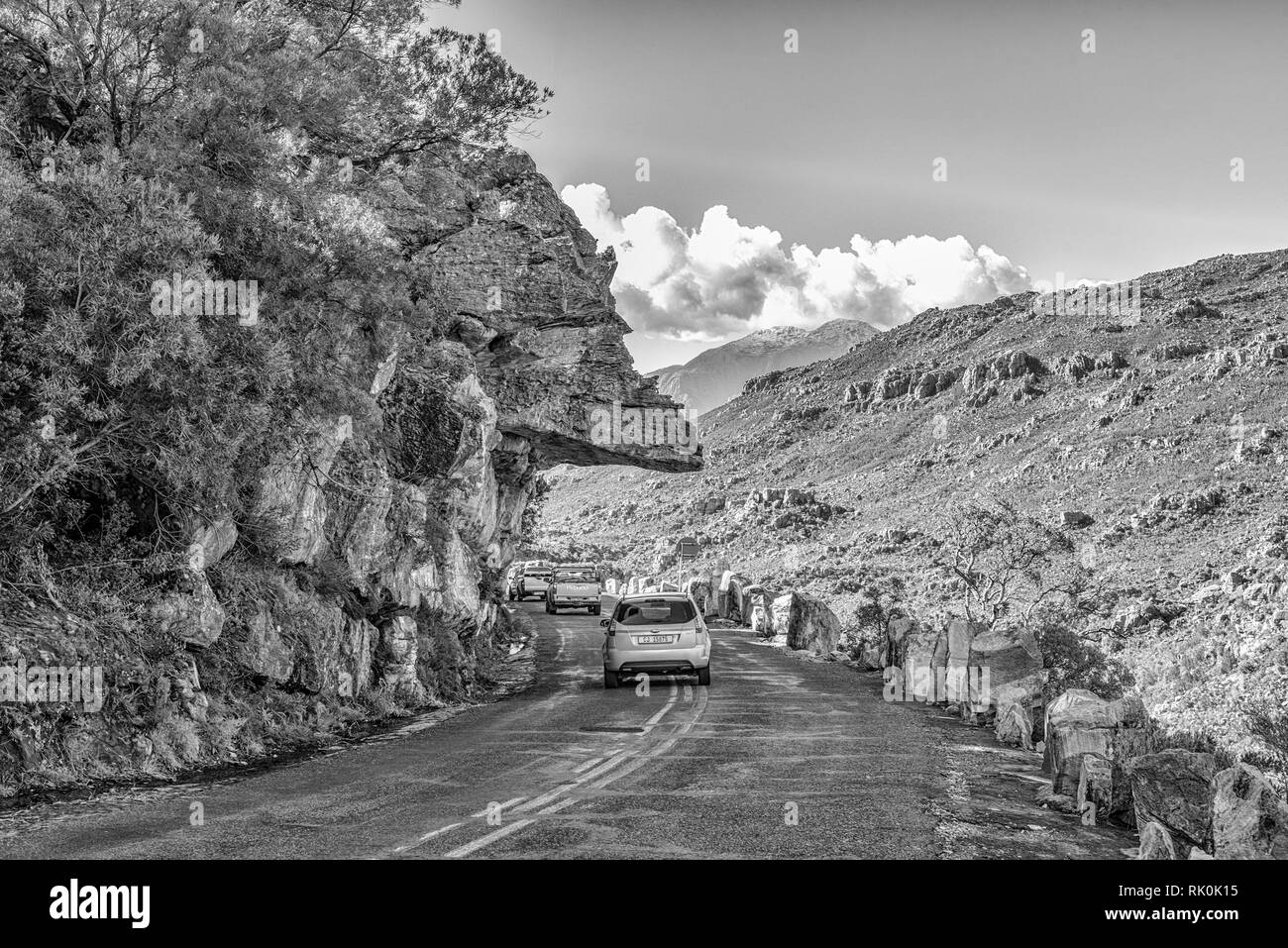 BAINS KLOOF, SOUTH AFRICA, AUGUST 8, 2018: Dacres Pulpit in the historic Bains Kloof Pass in the Western Cape Province. Vehicles are visible. Monochro - Stock Image
