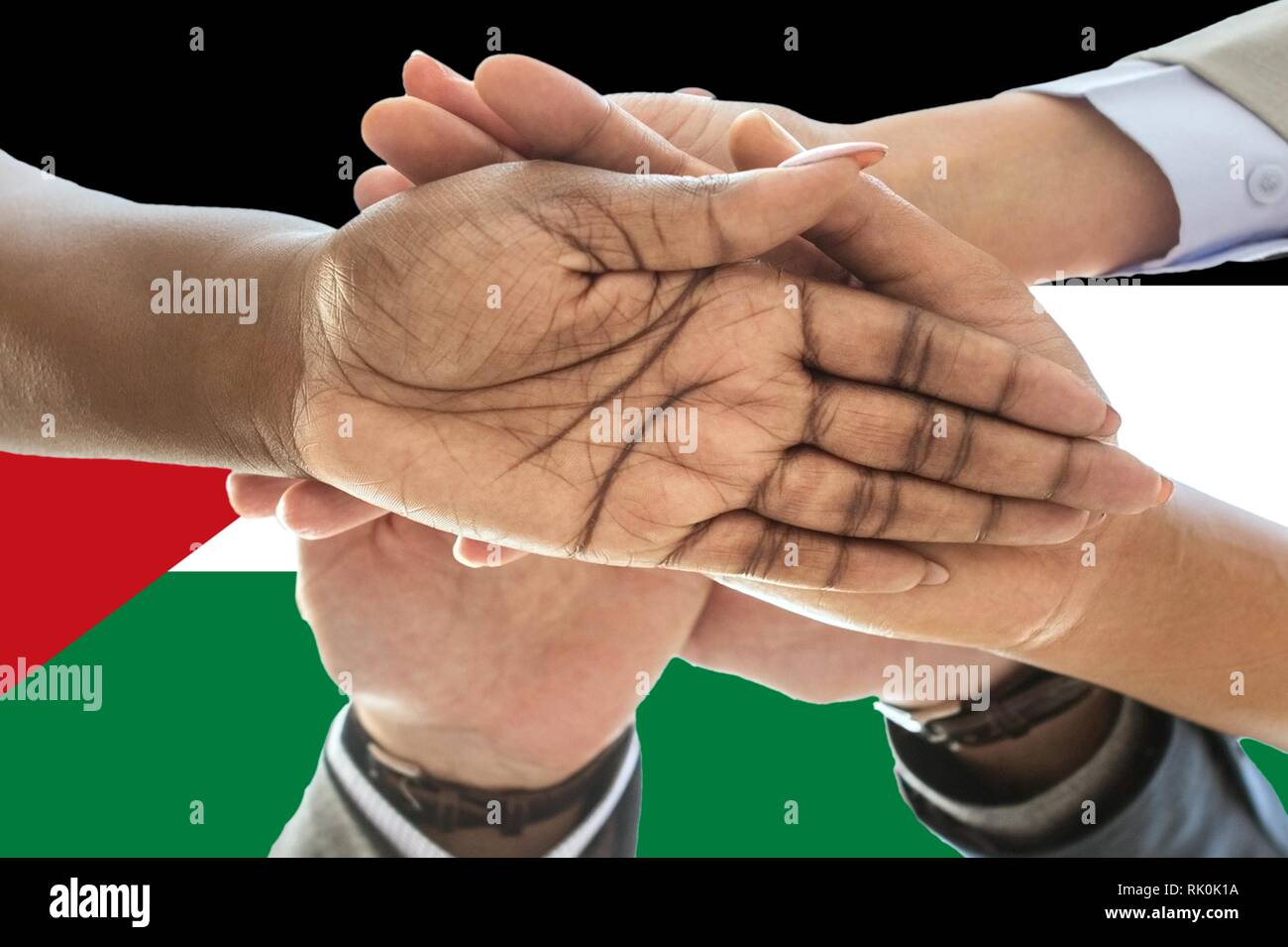 Sahrawi Arab Democratic Republic flag, intergration of a multicultural group of young people - Stock Image