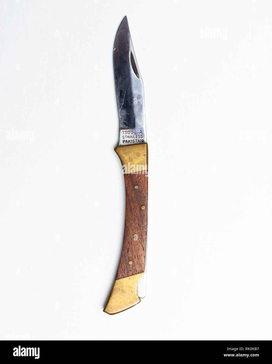 Vintage pocket knife open on white background - Stock Image