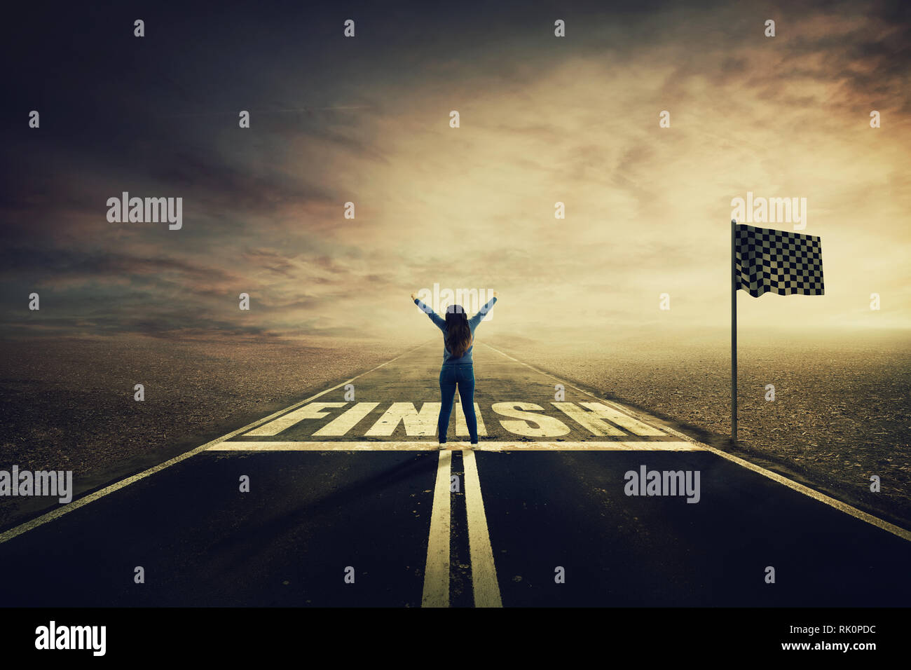 Competitive young woman on the road celebrate culmination raising hands up crossing the finish line. Surreal challenge winning concept, motivation and - Stock Image
