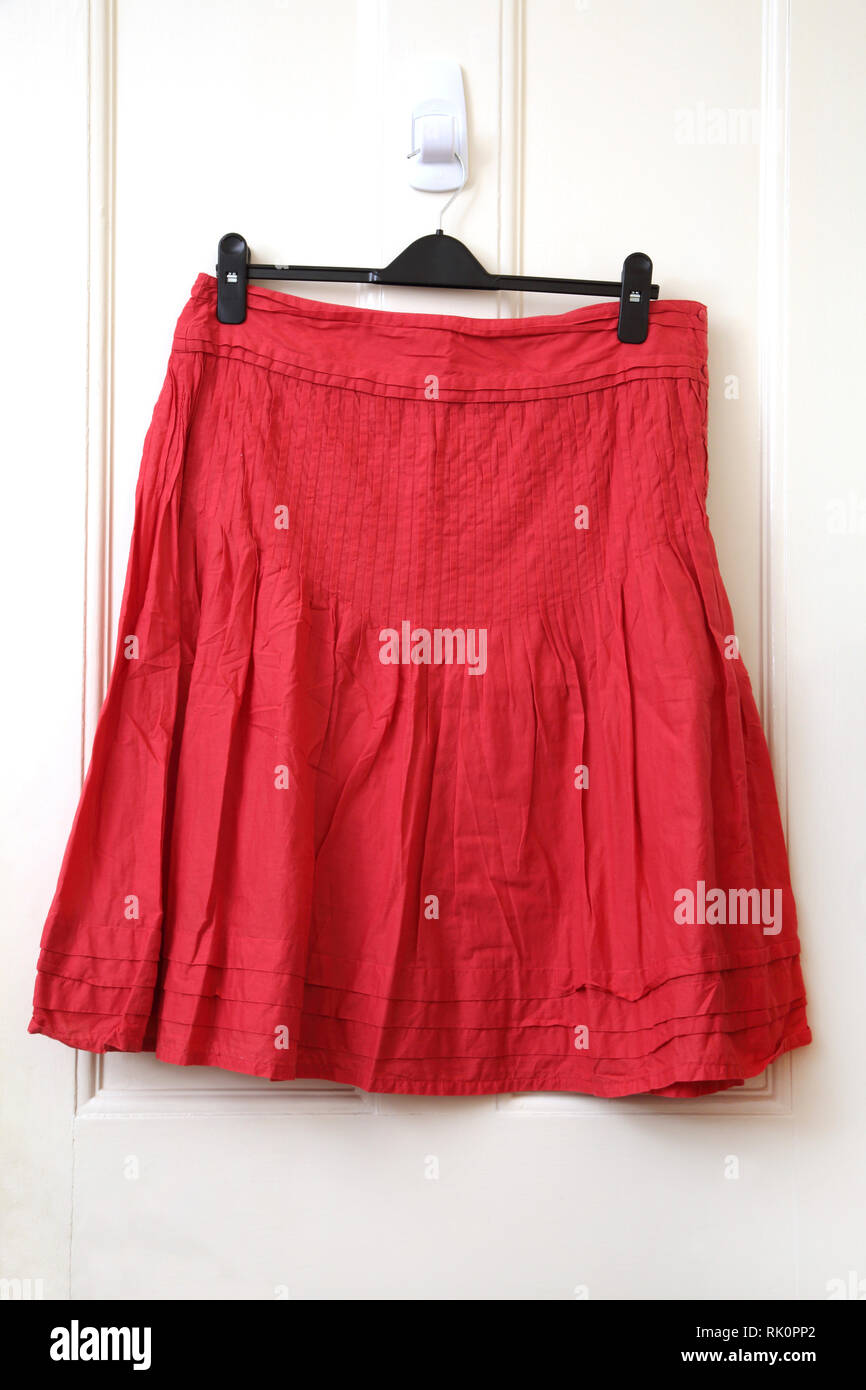 Red Pleated Knee Length Skirt - Stock Image