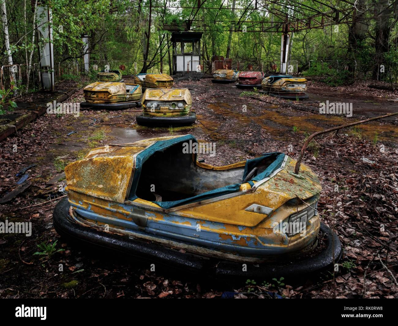 Pripyat city of ghost and playground abadoned cars. famous playground - Stock Image