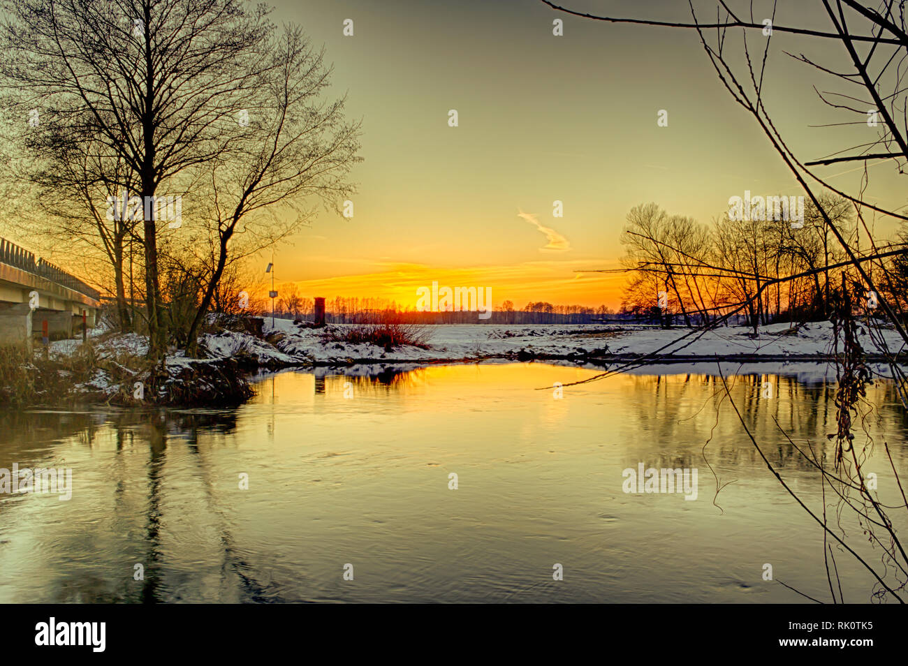 Winter sunset on the Widawka river in central Poland - Stock Image