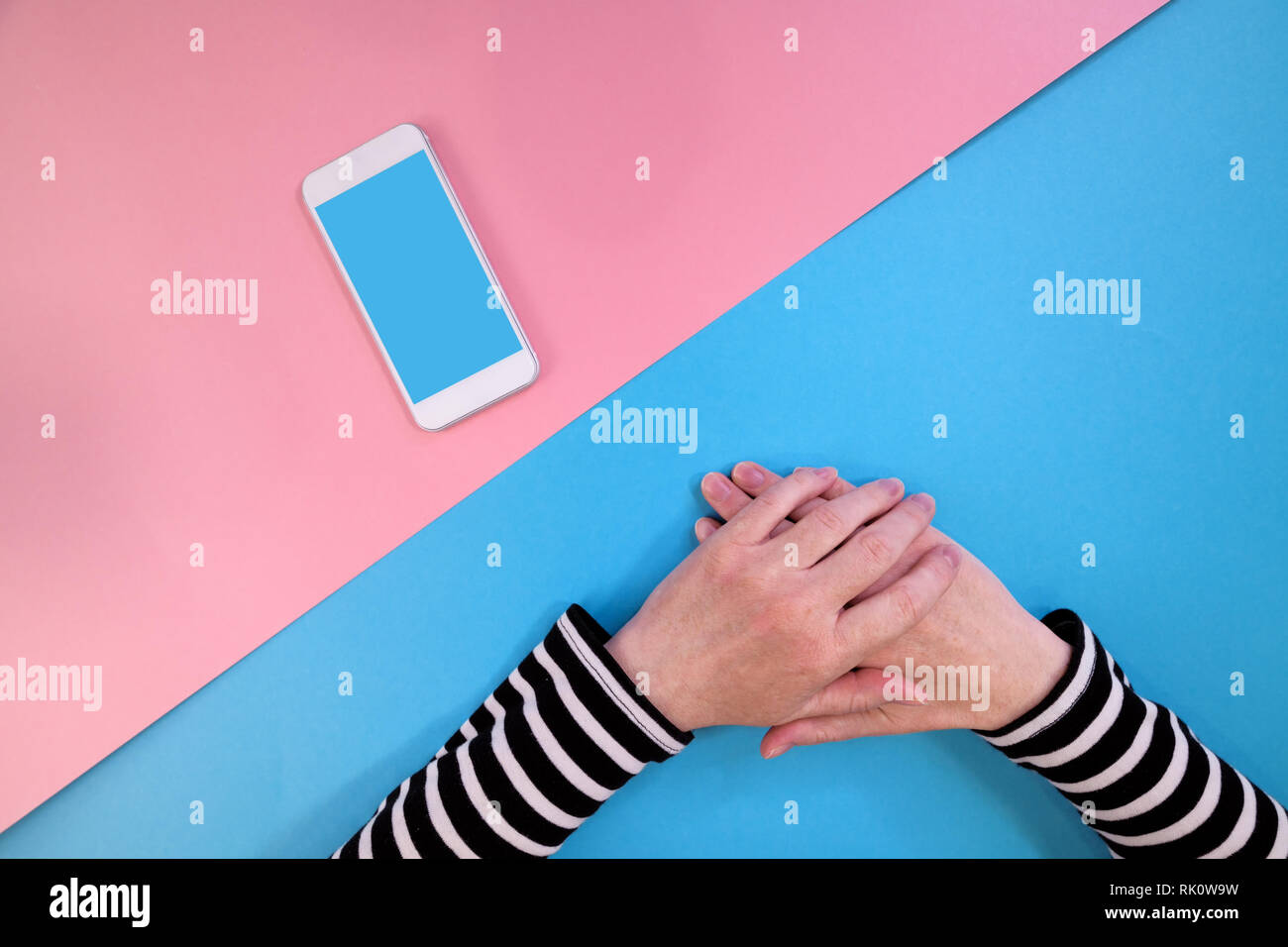 Female hands and modern smartphone mock up blank screen as copy space for mobile phone addiction concept - Stock Image