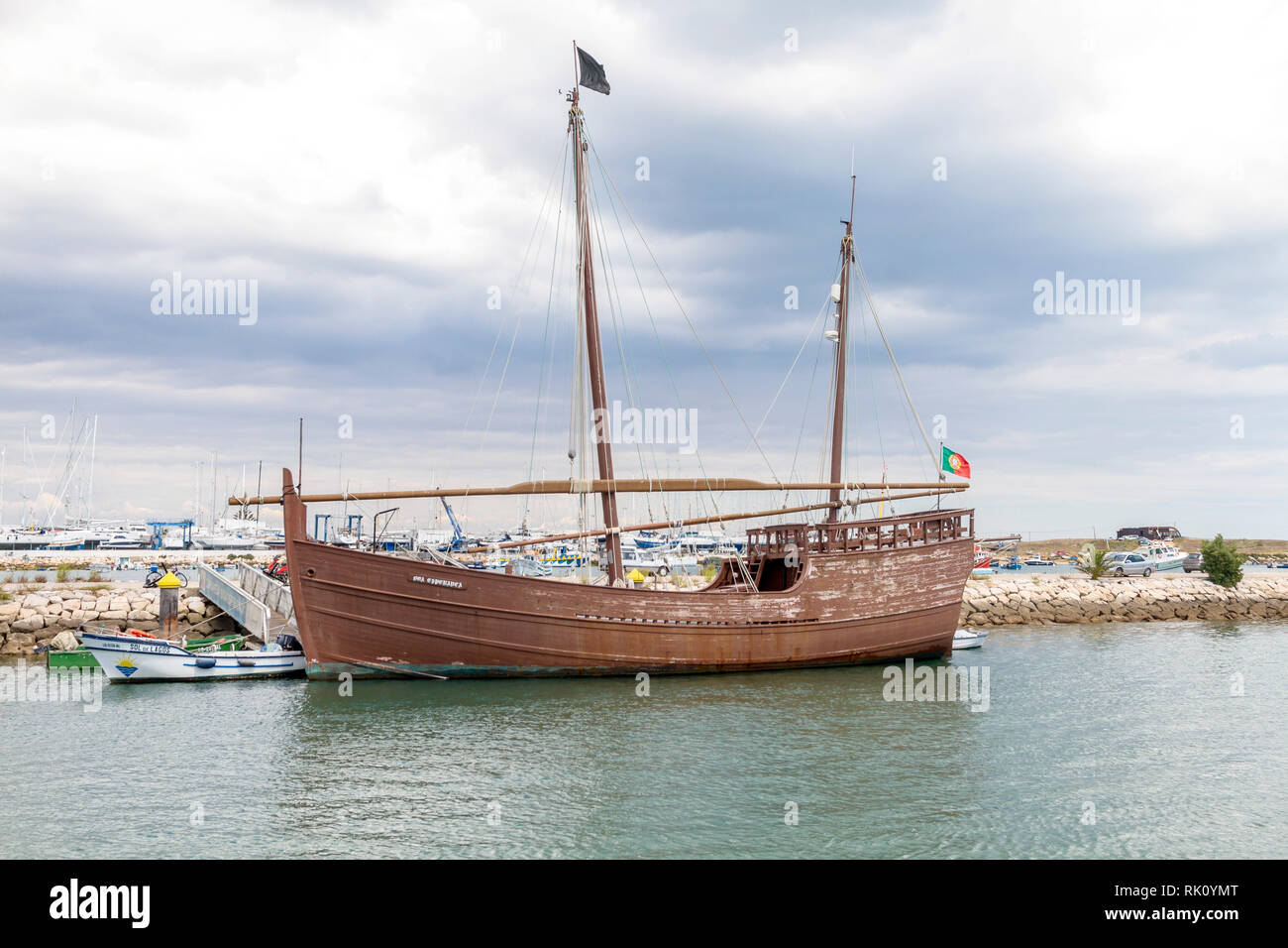 Replica Caravela Latina moored at Lagos, Algarve, Portugal - Stock Image