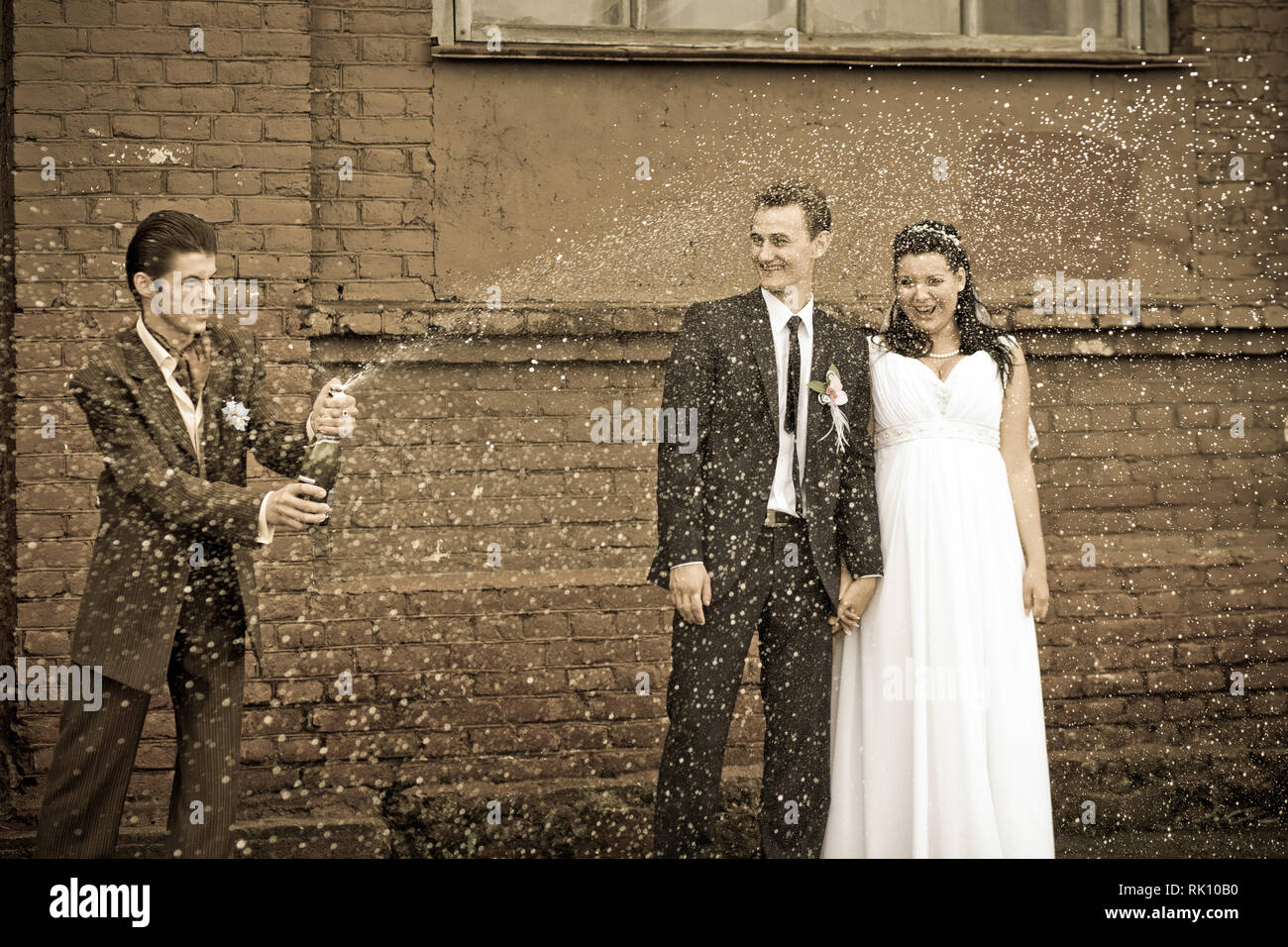 The bride and groom on the background of the champagne - Stock Image