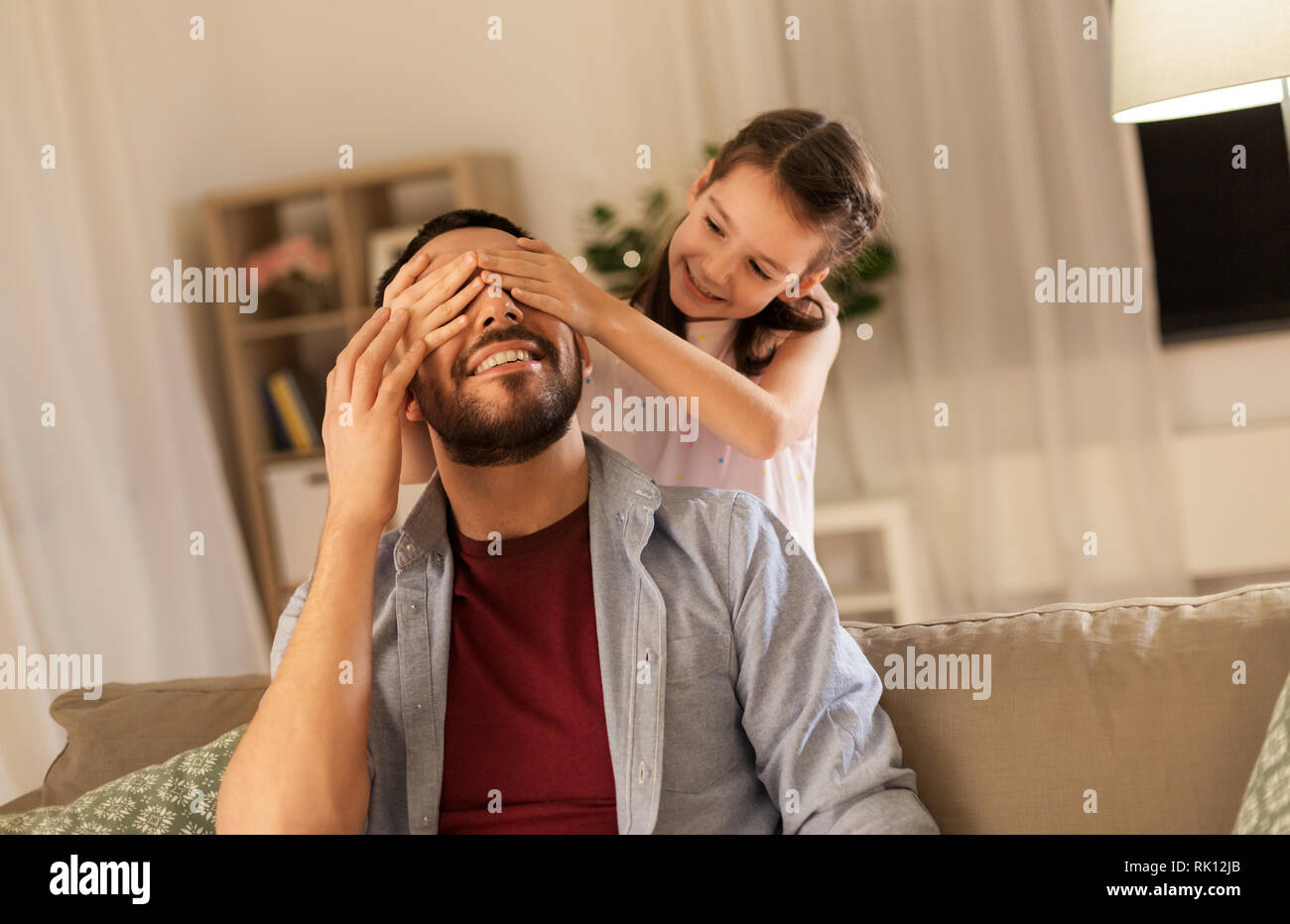 happy father and little daughter playing at home - Stock Image