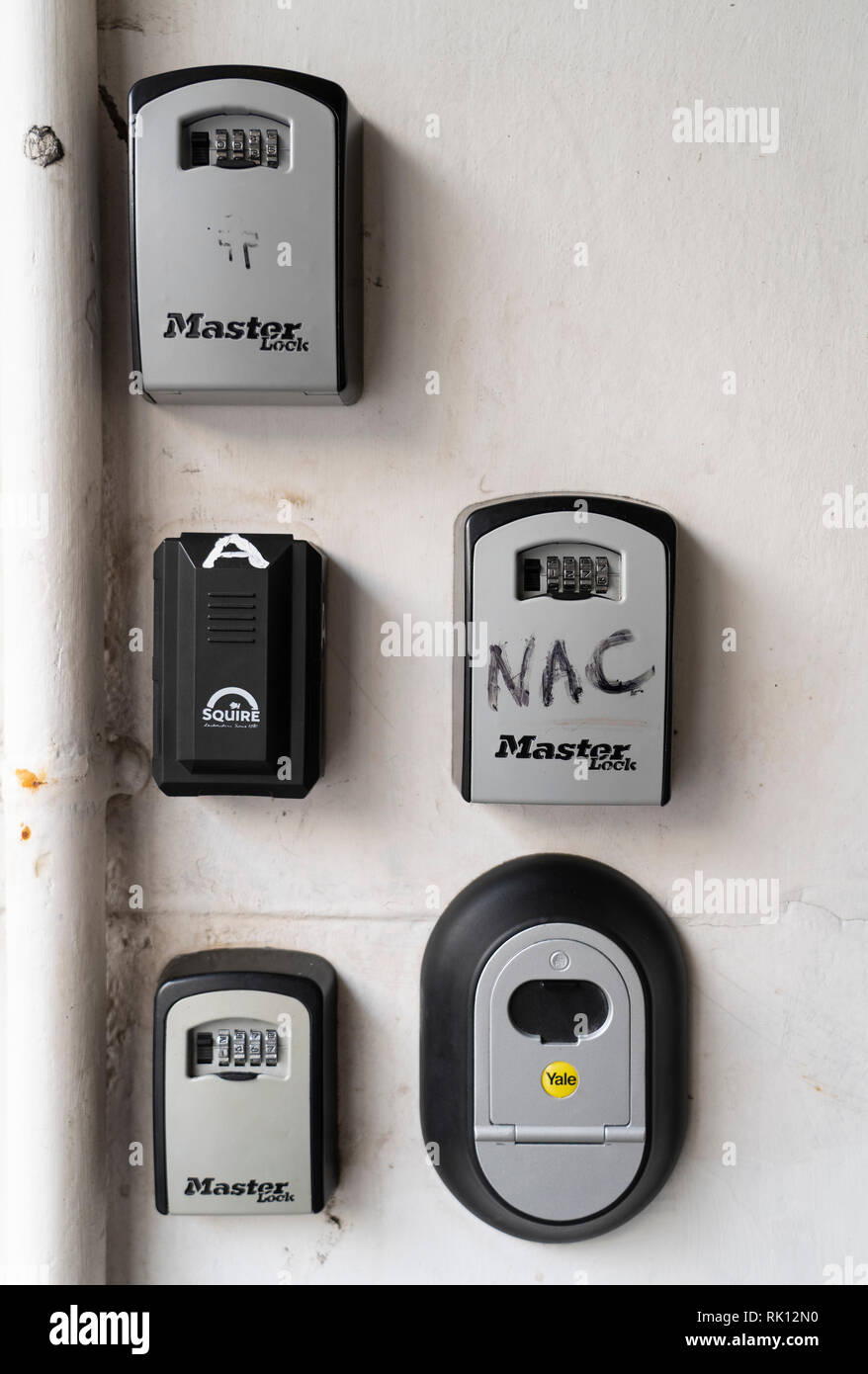Key boxes for AirbnB guests to access door keys outside apartment building in Edinburgh Old Town, Scotland, UK - Stock Image