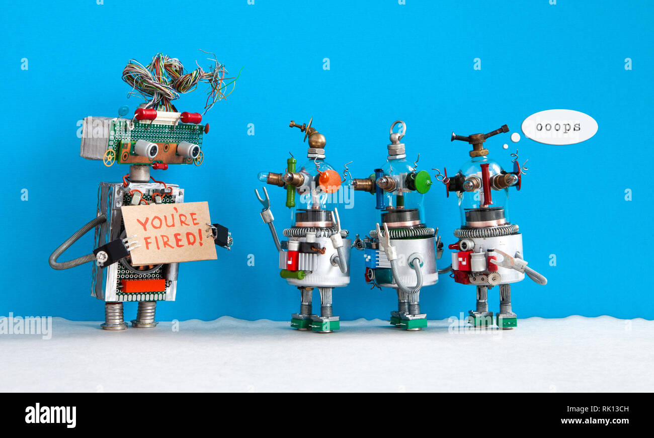 Robot chief dismisses three younger robotic employers. Three funny robots are dissatisfied with their dismissal. blue background - Stock Image