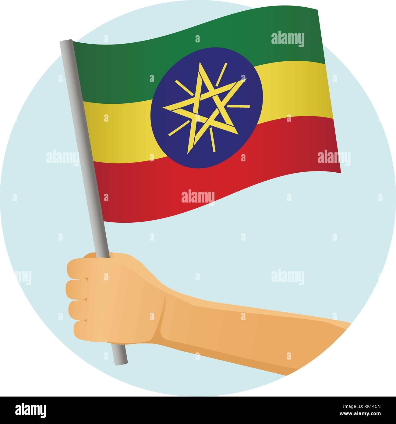 Ethiopia flag in hand. Patriotic background. National flag of Ethiopia vector illustration - Stock Vector