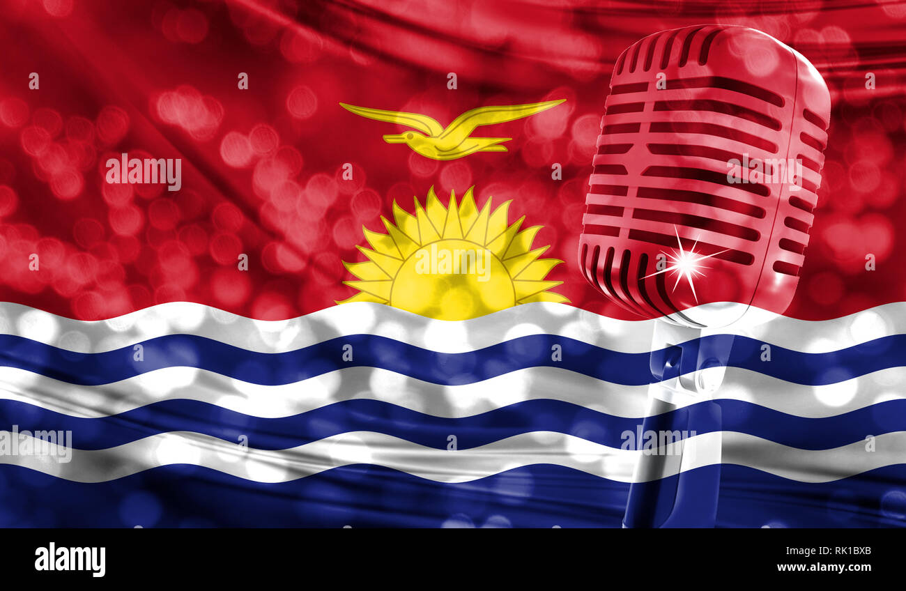 Microphone on a background of a blurry Kiribati flag close-up - Stock Image
