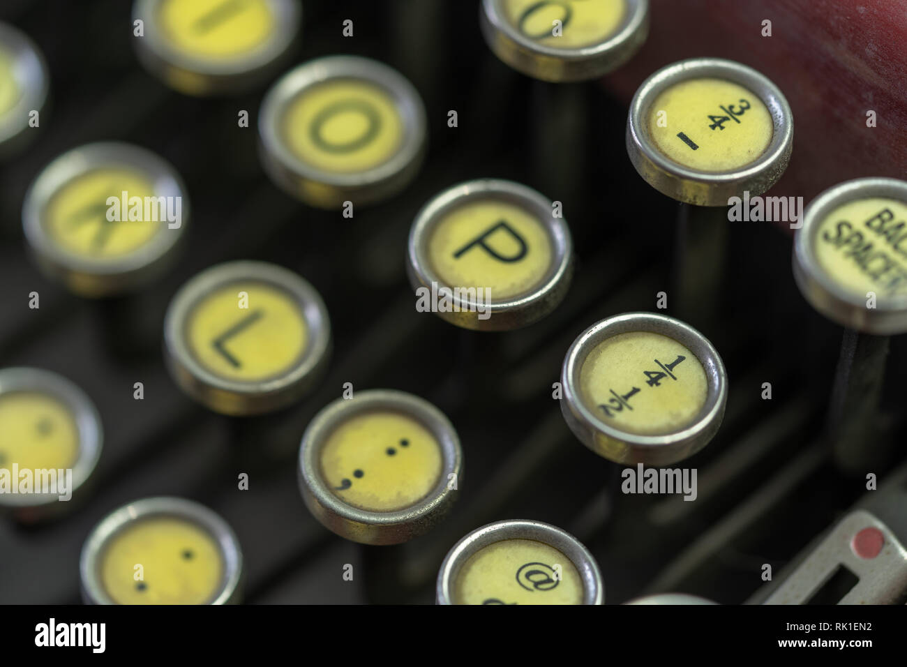 A closeup of the keys on an antique typewriter focusing on the fractional number 1/4. Stock Photo