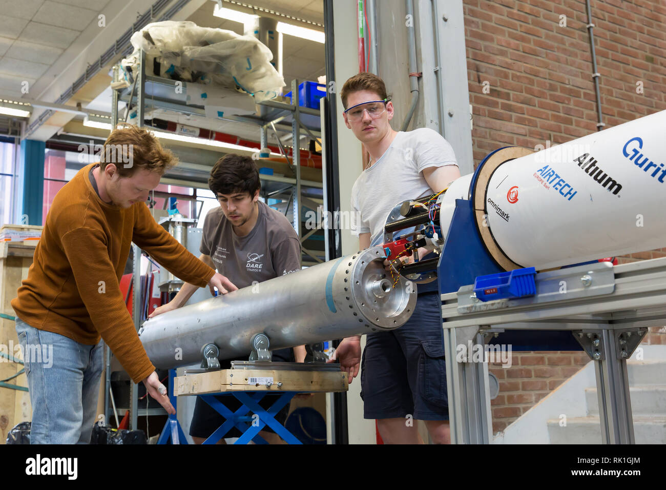 Aerospace engineering students of the Technical University of Delft working on their rocket, the Stratos III - Stock Image