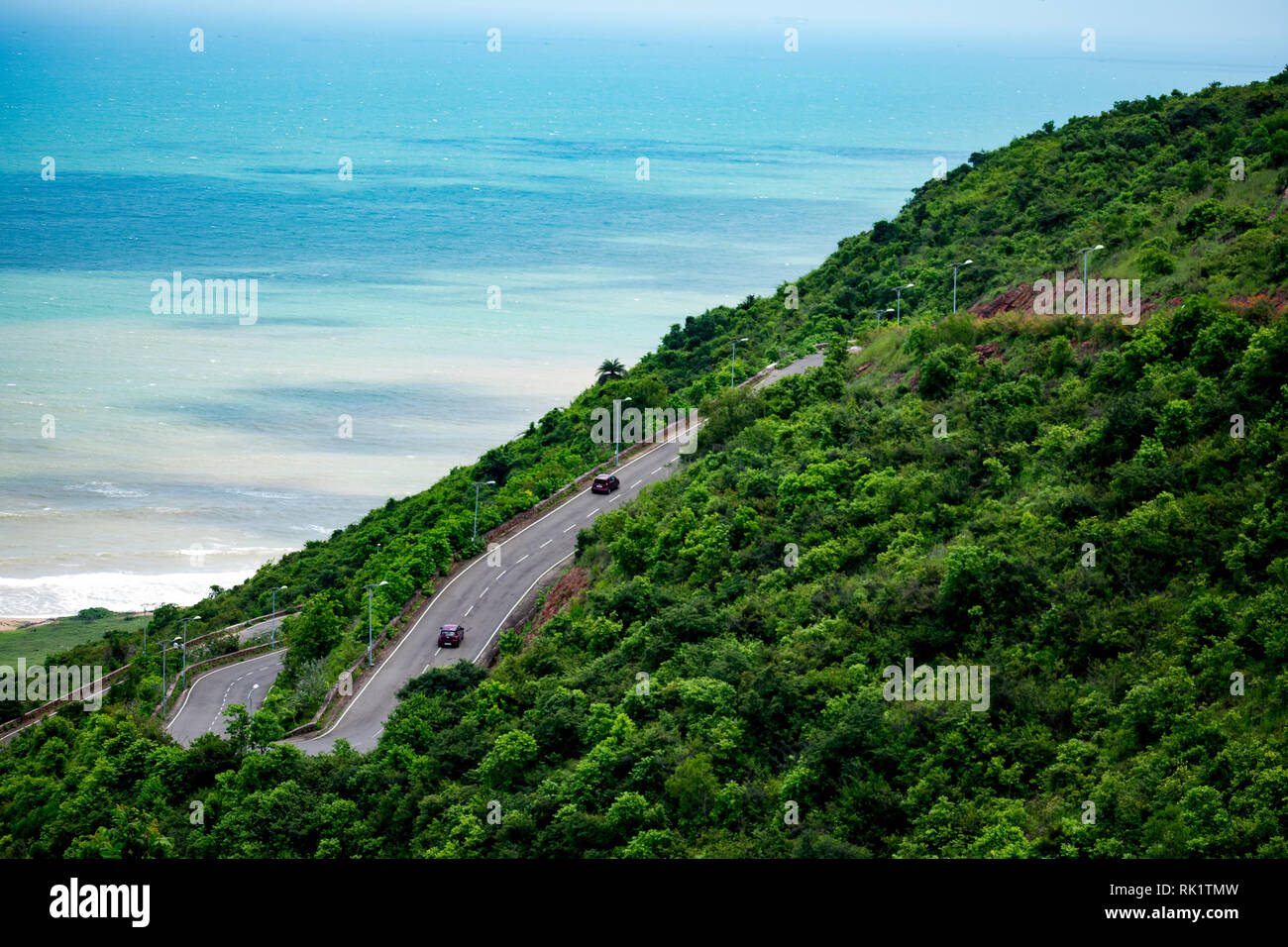 multilayer road going on a mountain looking awesome with a beach background. Stock Photo