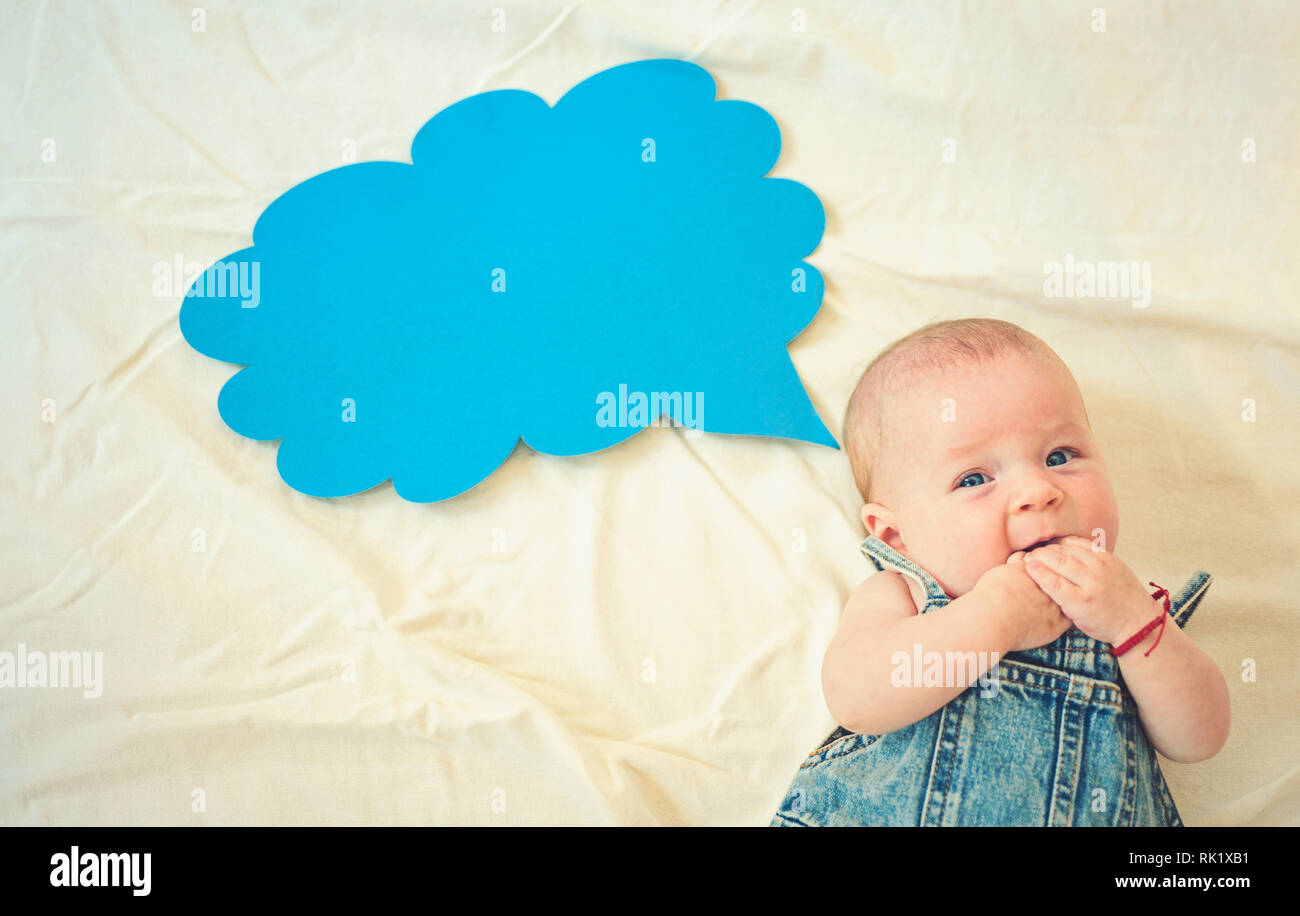 Say something. Childhood happiness. Small girl. I can speak. Word in cloud. Sweet little baby. New life and birth. Family. Child care. Childrens day - Stock Image
