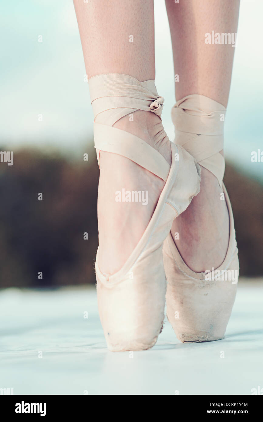 On The Tips Of The Toes Female Feet In Pointe Shoes Pointe Shoes Worn By Ballet Dancer Ballerina Shoes Legs In White Ballet Shoes Ballet Slippers Stock Photo Alamy