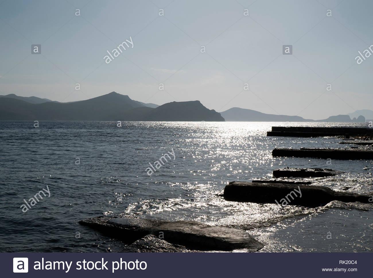View Across The Sea From Klima, Milos, Greece - Stock Image