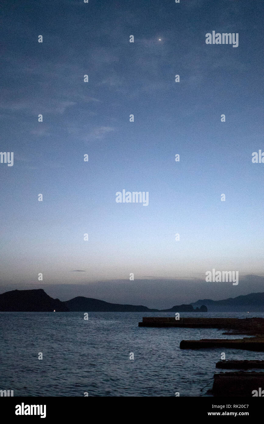 View Across The Sea at Dusk From Klima, Milos, Greece - Stock Image