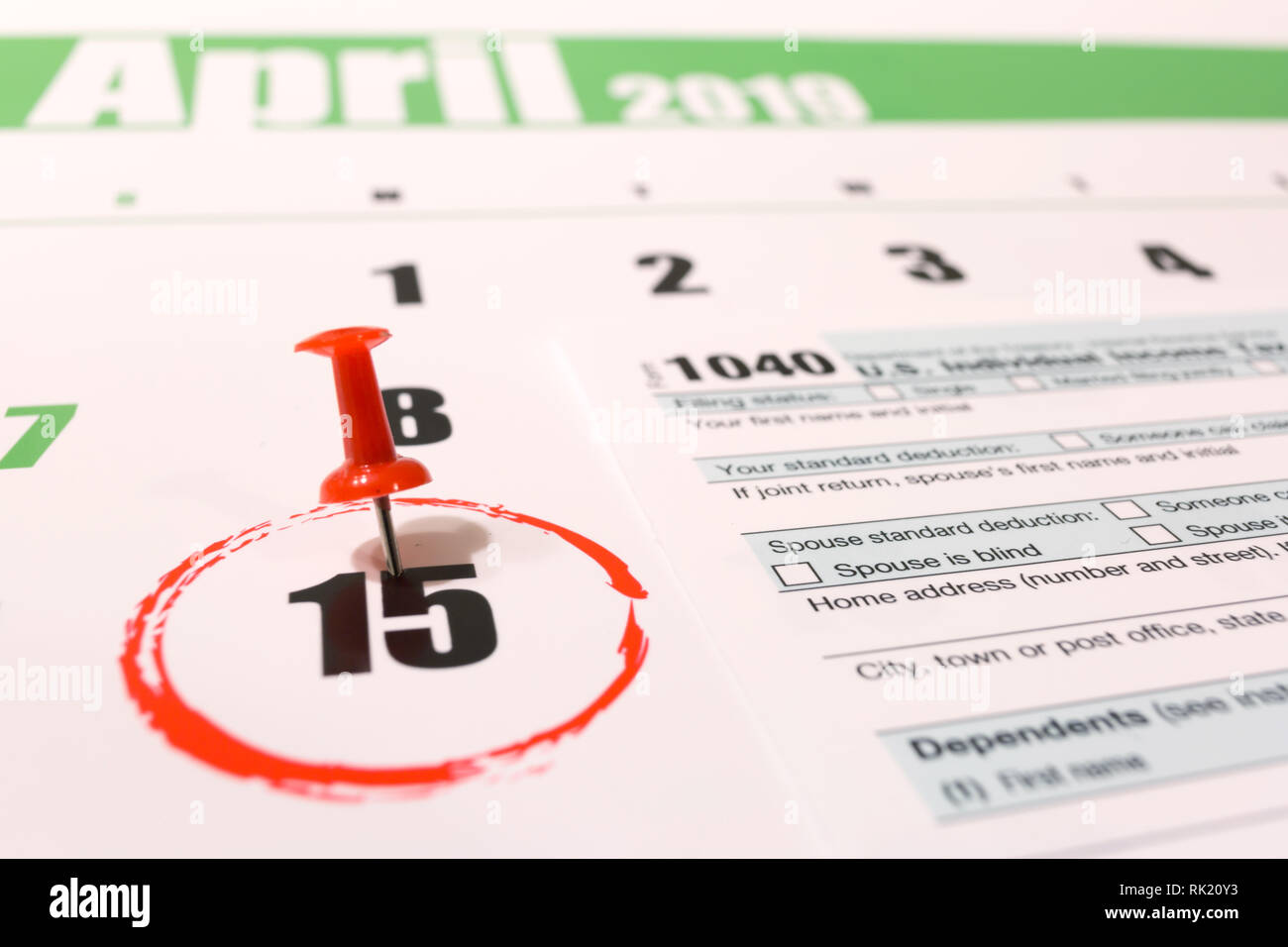 2019 calendar with 1040 income tax form for 2018 showing tax day for filing on April 15 Stock Photo