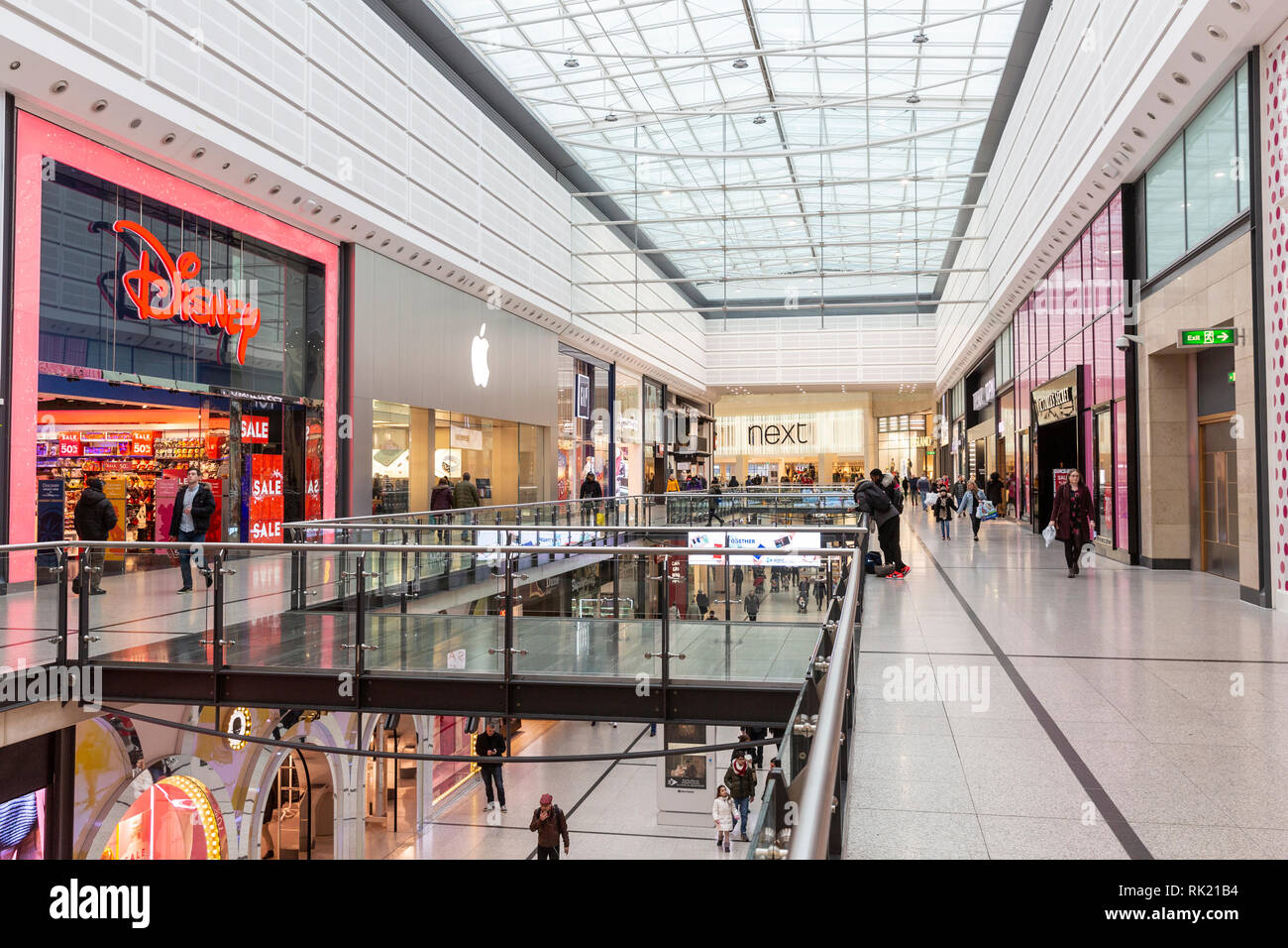 Interior of Manchester arndale centre with Disney store and Next store,Manchester,England - Stock Image