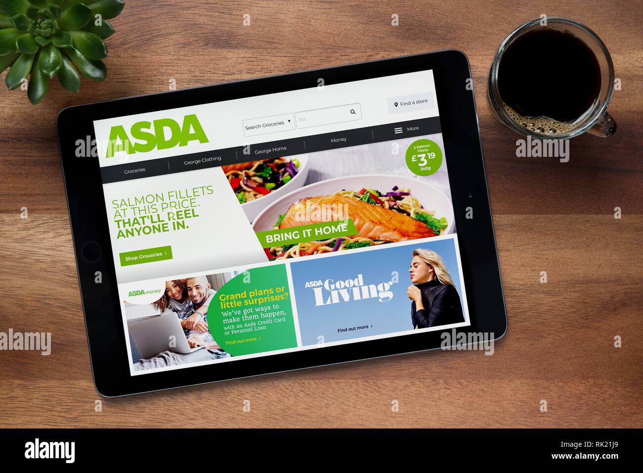 The Website Of Asda Is Seen On An Ipad Tablet On A Wooden