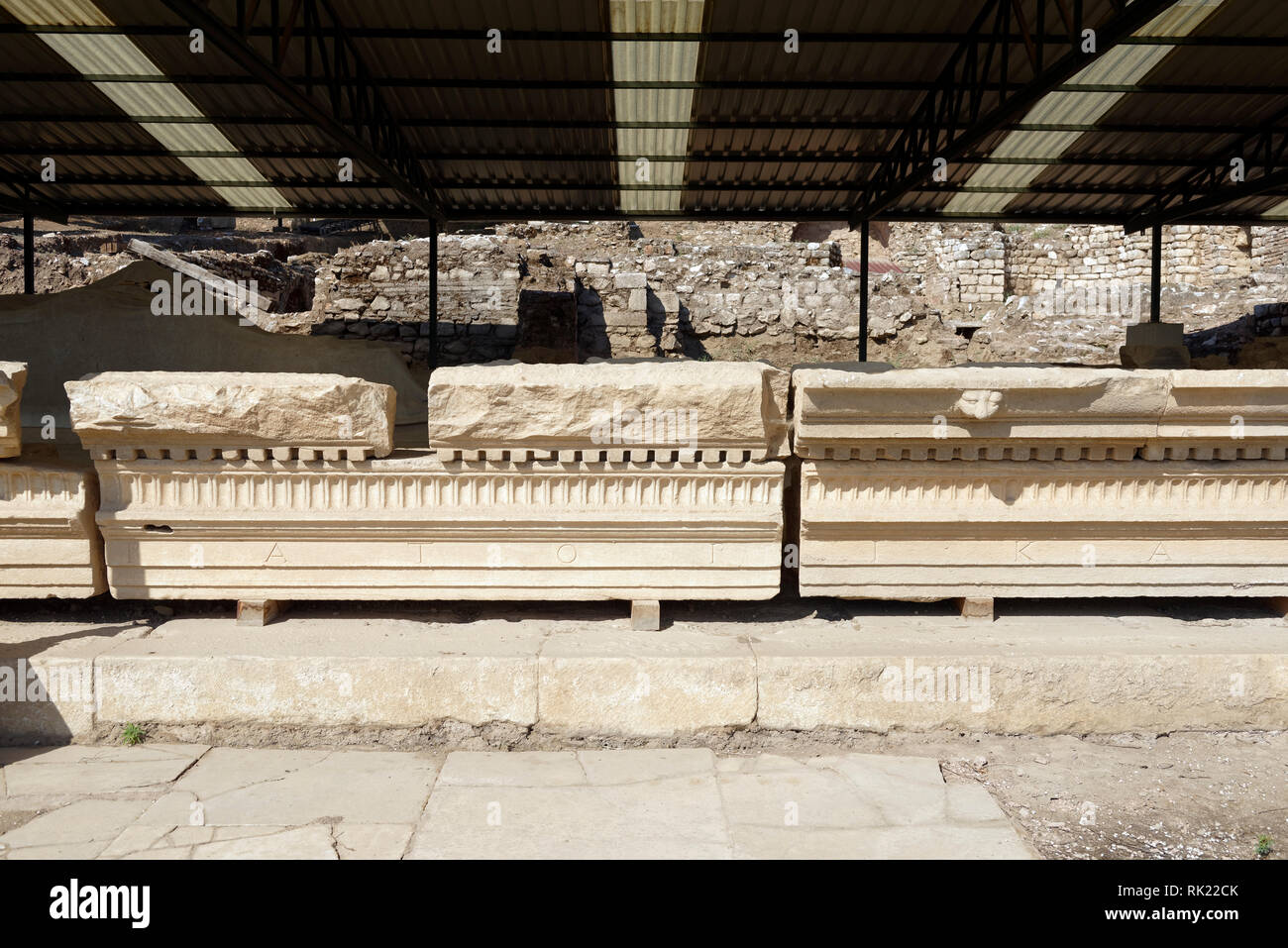 Section of the entablature of the Palestra portico with Greek inscriptions, Roman Imperial Bath and Palaestra complex, Metropolis, Ionia, Turkey. The  - Stock Image