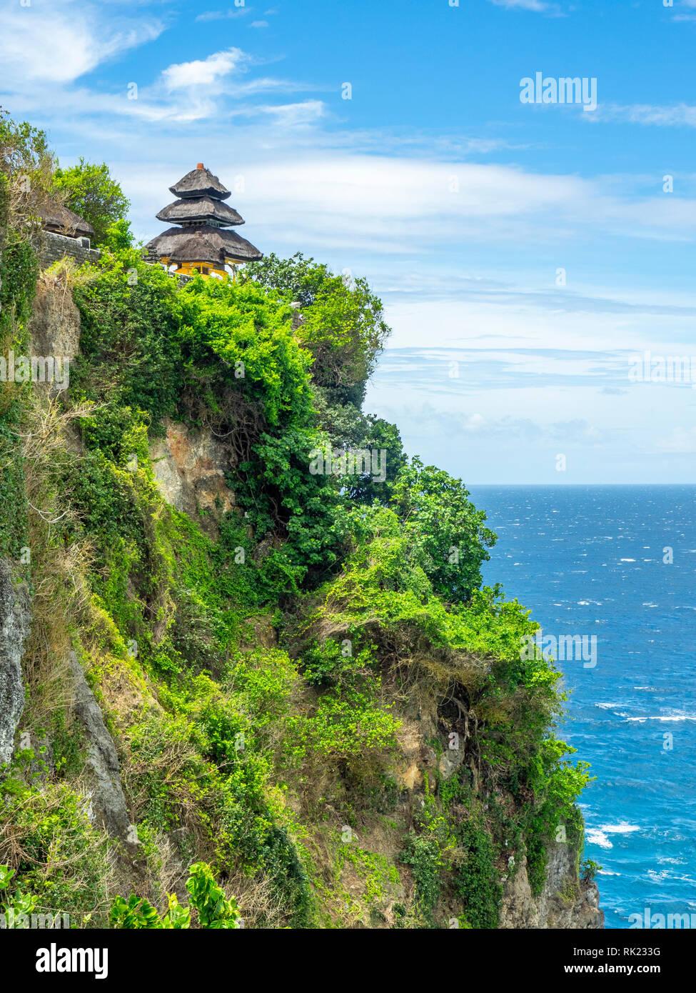 Uluwatu temple a pagoda perched on the cliffs of Bukit peninsula, Bali Indonesia. Stock Photo