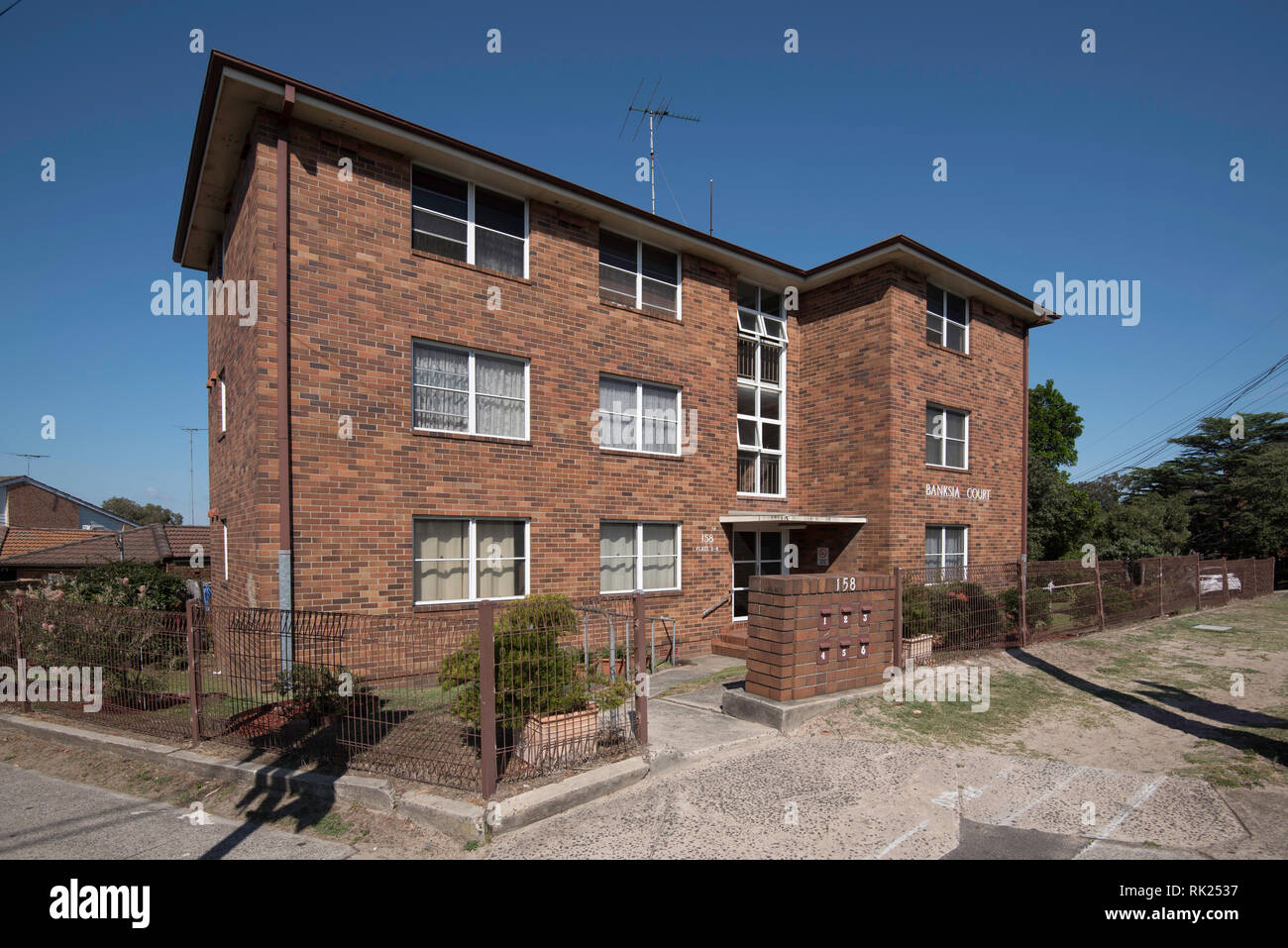 An early Sydney 3 level apartment, home-unit block (aka Flats) named Banksia. Built in Austere simple style with double brick and timber no balconies. - Stock Image