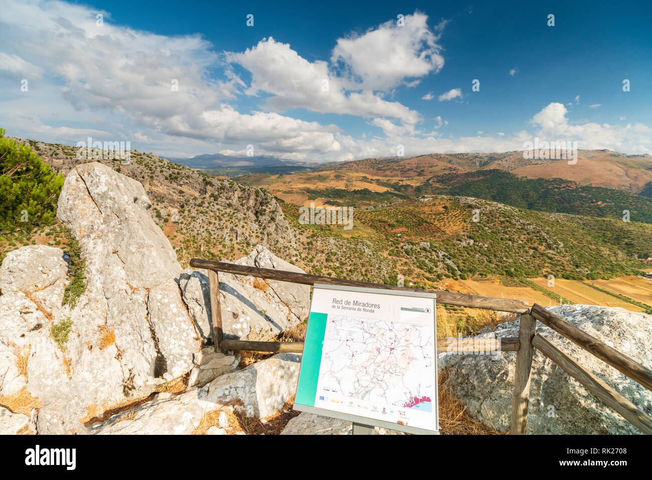 Mirador and hiking signboard in Sierra de Grazalema National Park surrounded by mountains, Serrania de Ronda, Malaga province, Andalusia, Spain - Stock Image