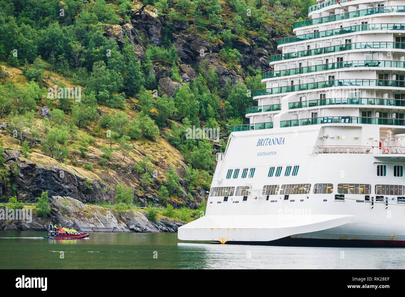 Pilot boat guiding cruise ship through river, Flam, Norway, Europe - Stock Image