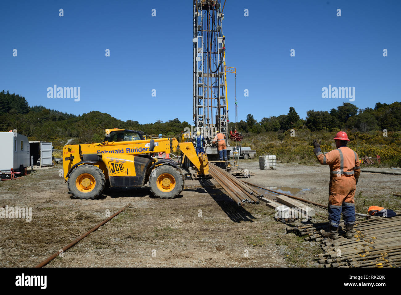 DOBSON, NEW ZEALAND, OCTOBER 13, 2018: Engineers feed the drill string down an old gas well in preparation for capping the well. - Stock Image