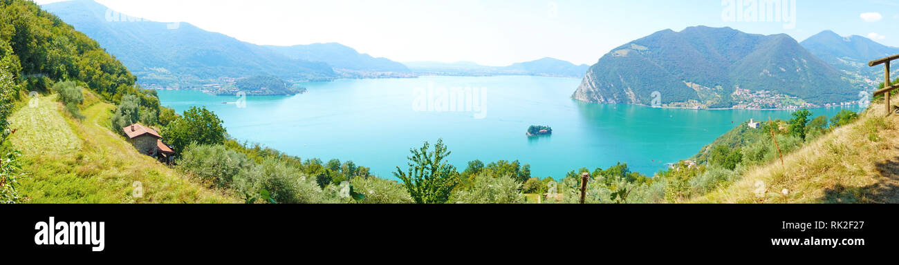 Panoramic view of mountain lake with island in the middle. Panorama from Monte Isola Island with Lake Iseo. Italian landscape. Island on lake. View fr - Stock Image