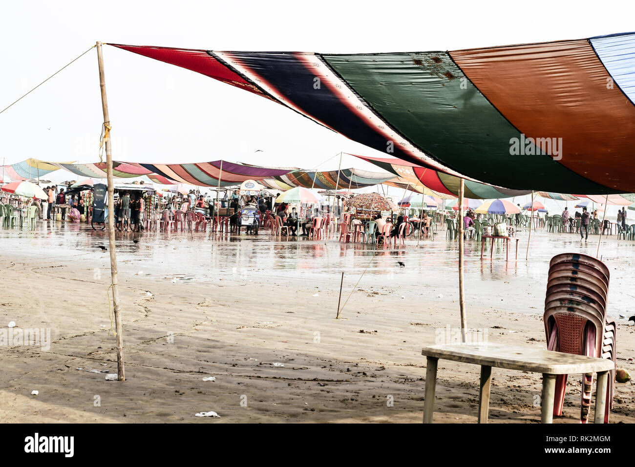 Versova beach, Mumbai India 10, Jan 2019: Beach market View of crowded with tourists and vendors in during new year festival, causes water pollution d - Stock Image