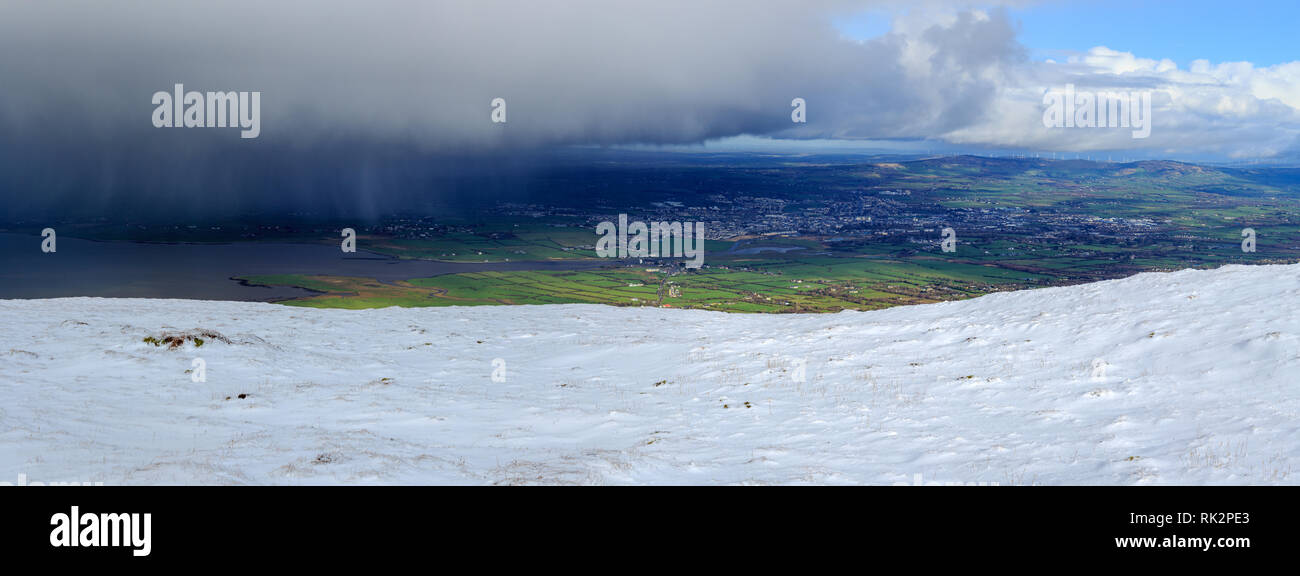 Dark Rain Clouds approach Tralee Town on the Wild Atlantic Way in County Kerry, Ireland - Stock Image