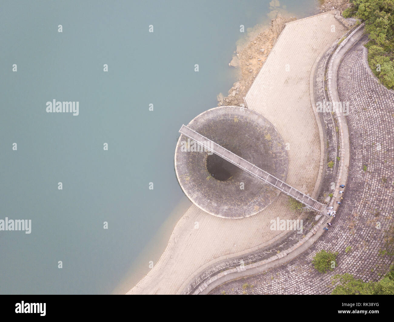 The bellmouth of the Shing Mun Reservoir in Hong Kong seen by drone - Stock Image