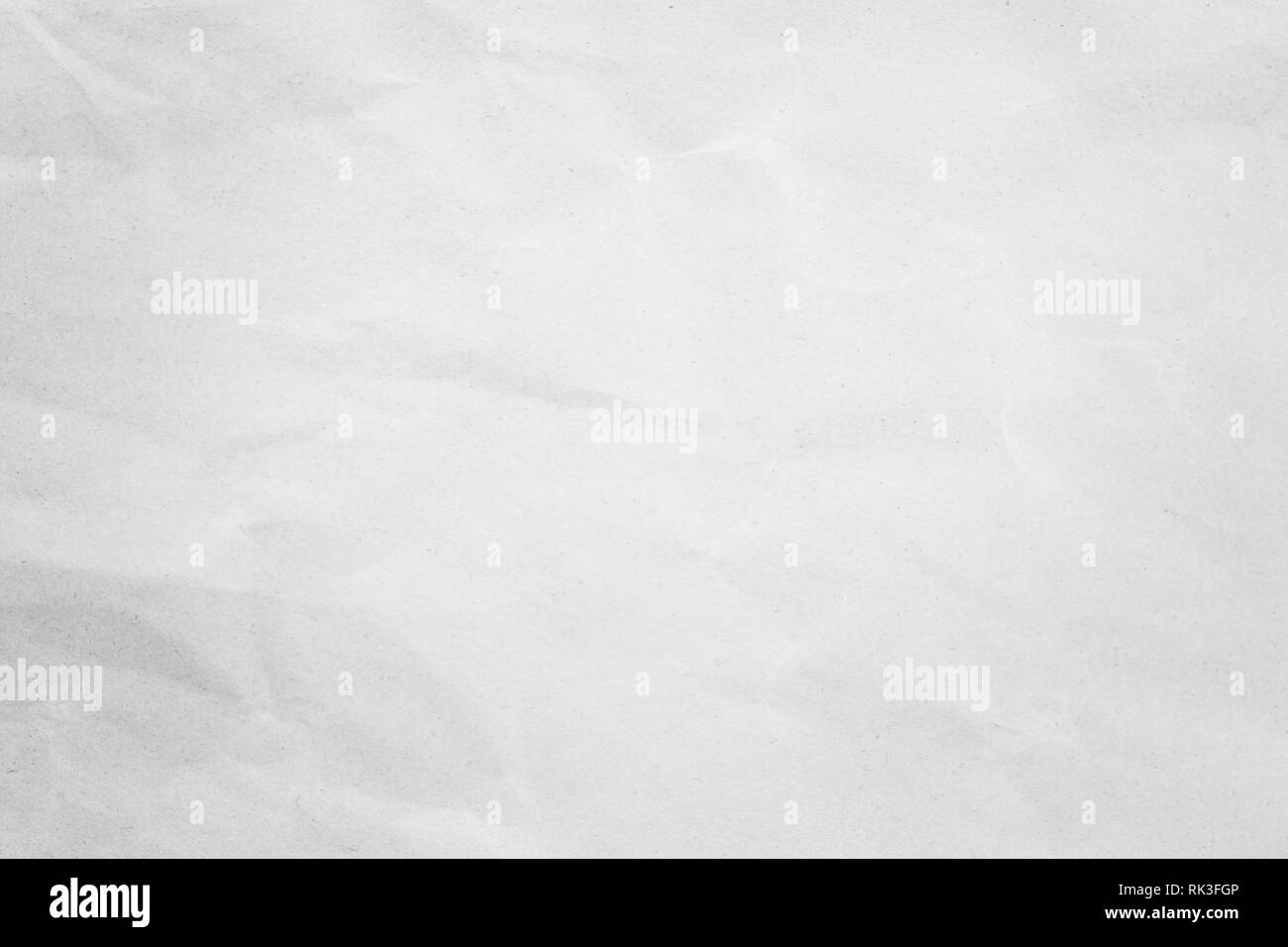 White background paper, crumpled texture and watercolor. Old vintage page with a glowing center and grunge vignette. - Stock Image