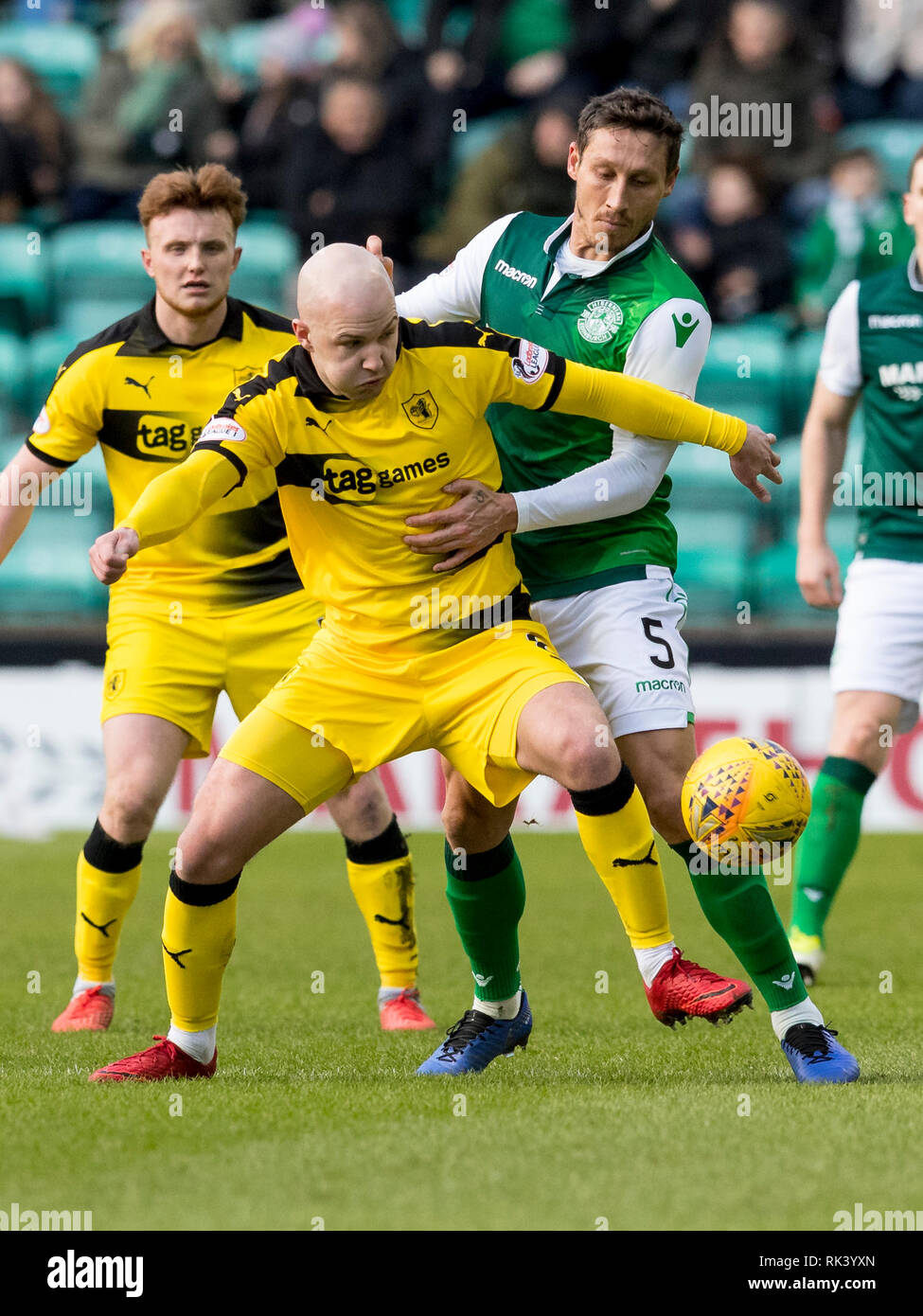 Easter Road, Edinburgh, UK. 9th Feb, 2019. Scottish Cup football fifth round, Hibernian versus Raith Rovers; Grant Gillespie of Raith Rovers and Mark Milligan of Hibernian compete for possession of the ball Credit: Action Plus Sports/Alamy Live News Stock Photo