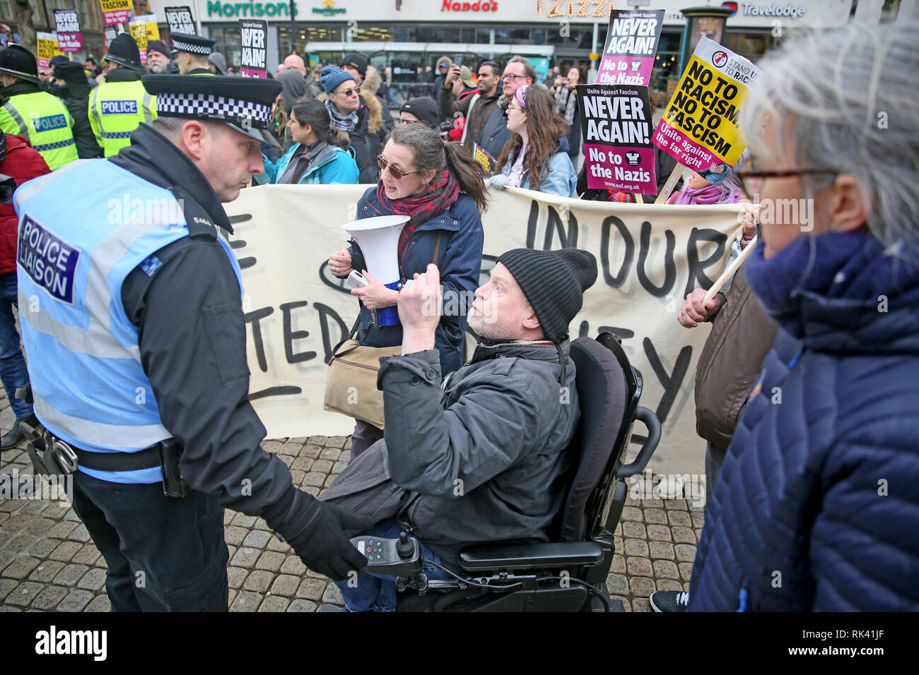 Manchester, UK. 09th February, 2019. A community Police officer speaking to an anti racist during a Stand up to racism rally. Piccadilly Gardens, Manchester, UK. 9th Feb, 2019. (C)Barbara Cook/Alamy Live News Credit: Barbara Cook/Alamy Live News - Stock Image