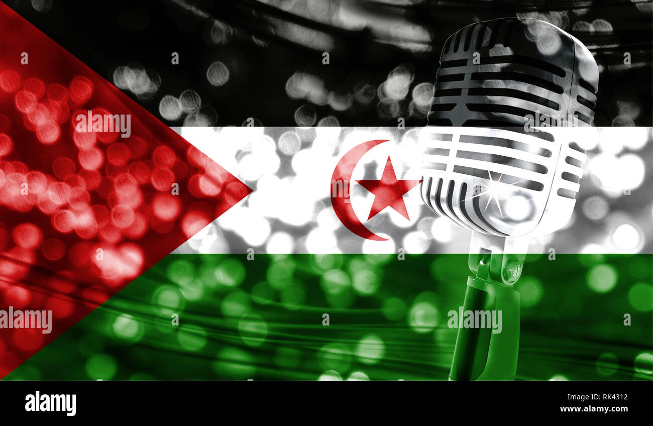 Microphone on a background of a blurry Western Sahara flag close-up - Stock Image