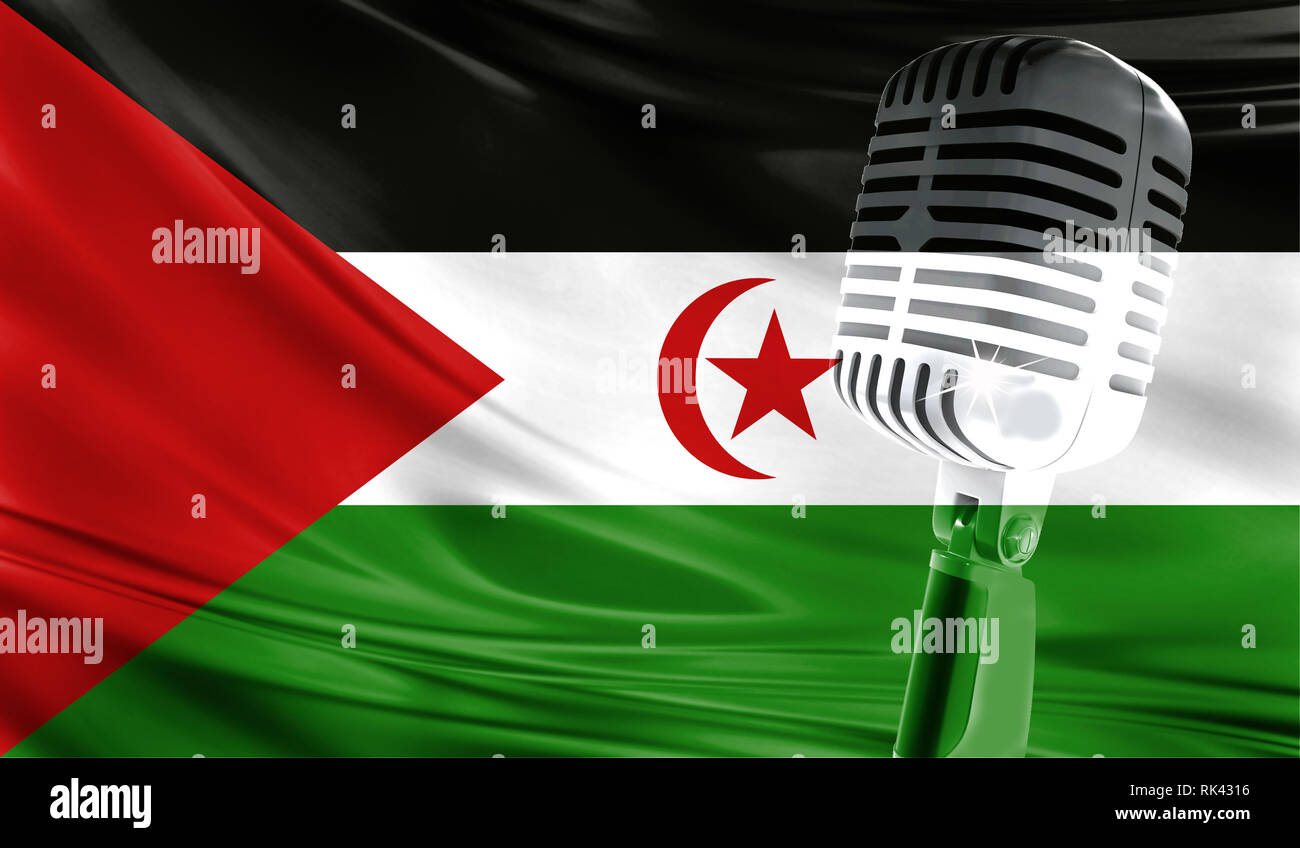 Microphone on fabric background of flag of Western Sahara close-up - Stock Image