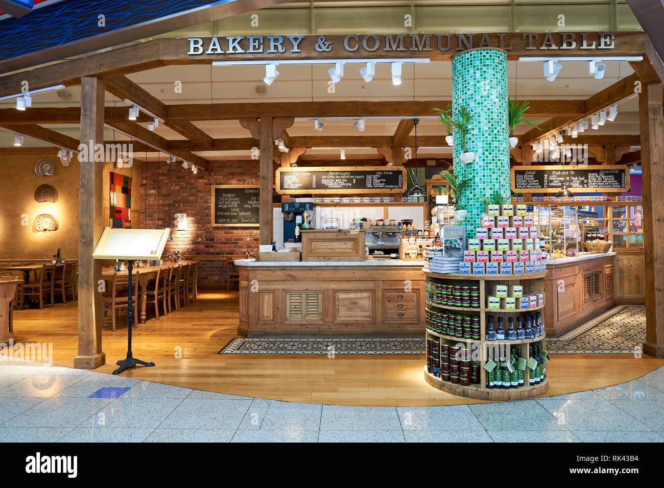 DUBAI, UAE - APRIL 08, 2016: inside of Dubai International Airport. There are a lot of restaurants, bars, cafes and shops in Dubai International Airpo - Stock Image