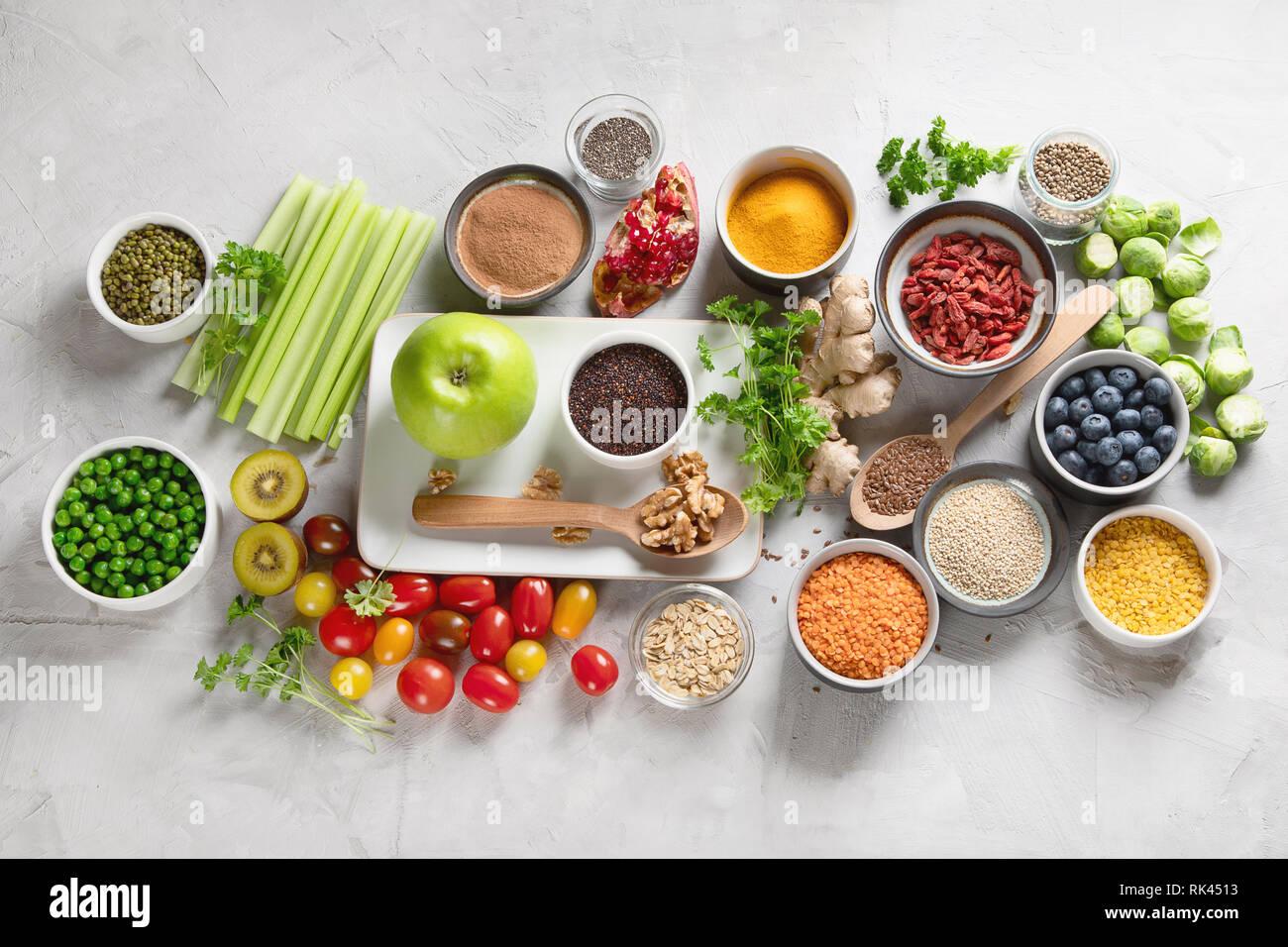 Vegetables, fruit, grain, superfoods for vegan and vegetarian eating. Clean eating. Detox, dieting food concept Stock Photo