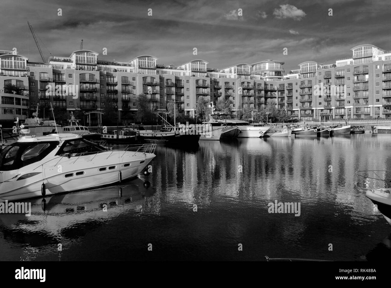 Boats in St Katherines dock, North Bank river Thames, London City, England, United Kingdom - Stock Image