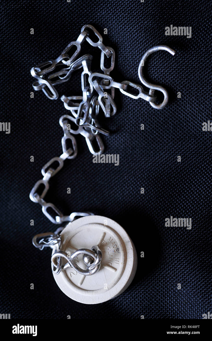 rubber sink plug and chain - Stock Image