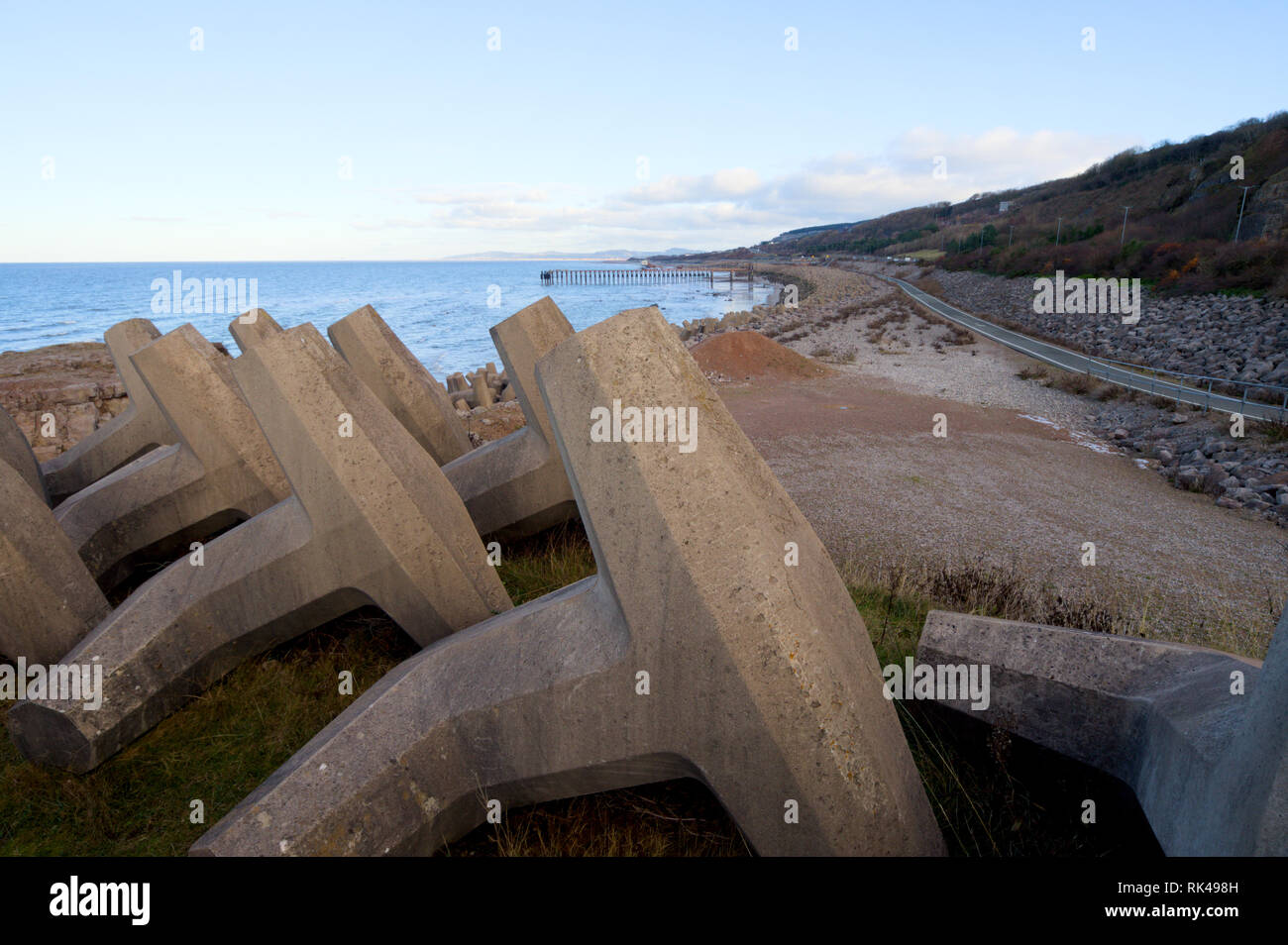 Dolosse at the breakwater in Old Colwyn, Colwyn Bay, North Wales, guarding the A55 North Wales Expressway from the harsh seas. - Stock Image